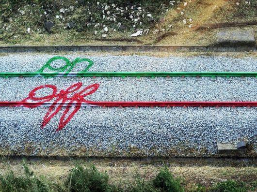 Clever Urban Art On Railroad Tracks